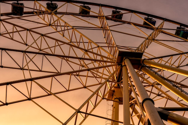 Ferris wheel processed and sunset. bottom view