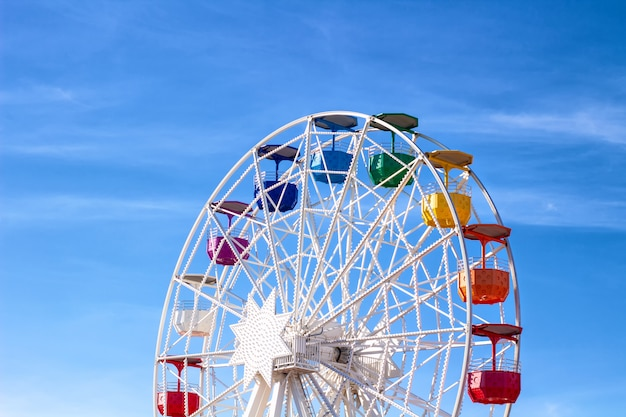 Ferris wheel with multi-colored cabs.