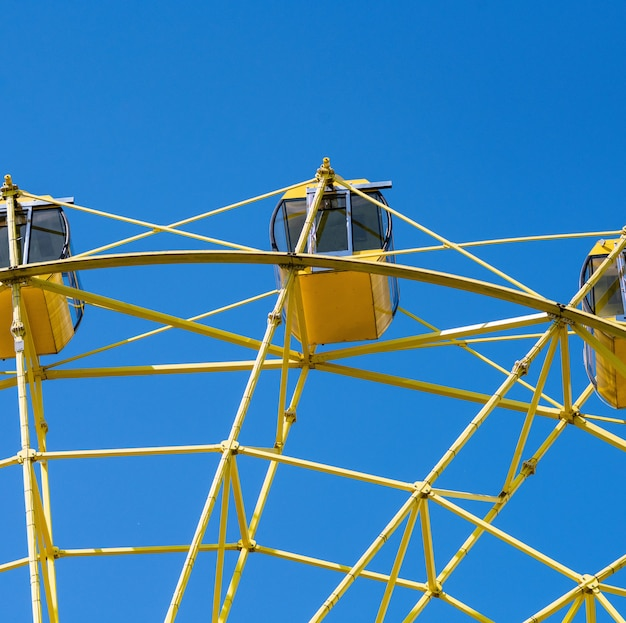 Ferris wheel with yellow cabins