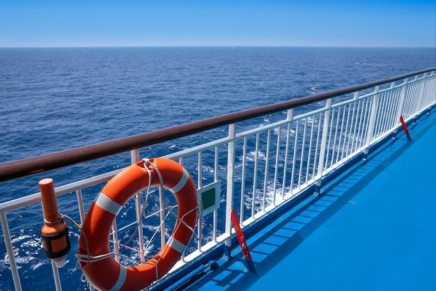 Ferry cruise railing in a blue ocean buoy