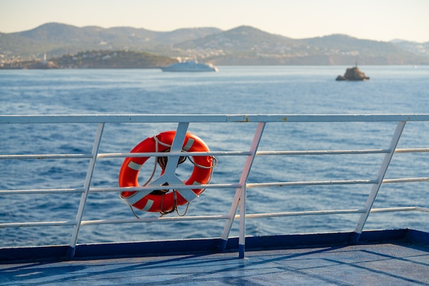 Ferry railing in ibiza with round buoy