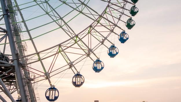 Ferry wheel on sunset sky