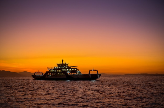 Ferry with sunset in puntarenas costa rica.