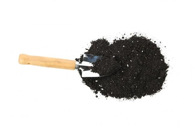 Fertile soil and shovel isolated on white isolated