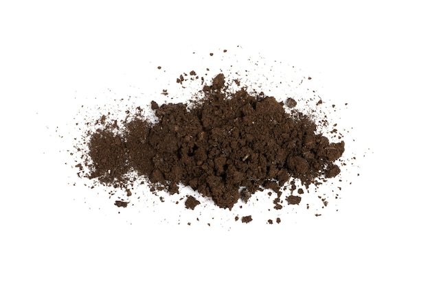 Fertilized dry dirt soil isolated. dried ground pile, manure soil, arid dirt, natural black dirty earth texture on white background top view