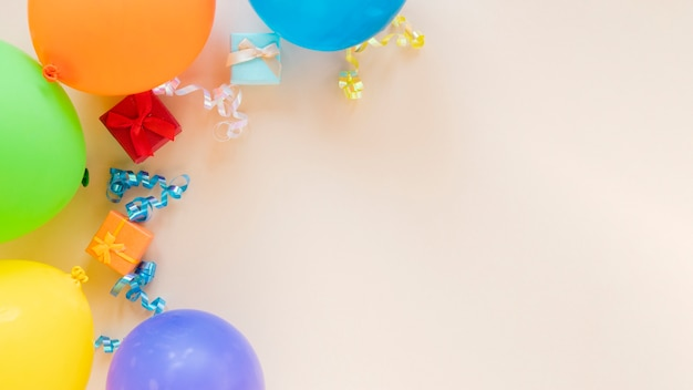 Festive arrangement for birthday party with balloons and copy space
