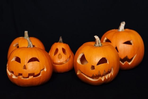 Festive autumn card with orange pumpkins for halloween