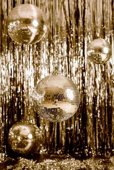 Festive background. disco ball on beige and fortuna gold background.
