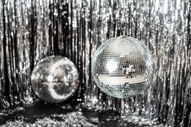 Festive background. disco ball on beige and silver background.