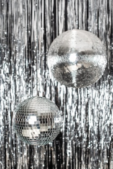 Festive background. disco ball on beige and silver background