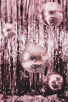 Festive background. disco ball on pink background.