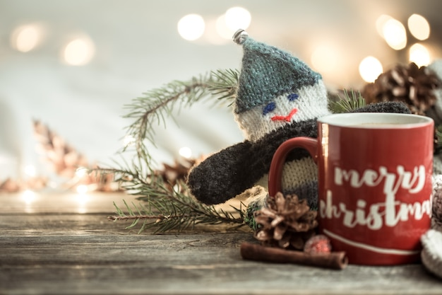 Festive background with a cup and the inscription merry christmas.