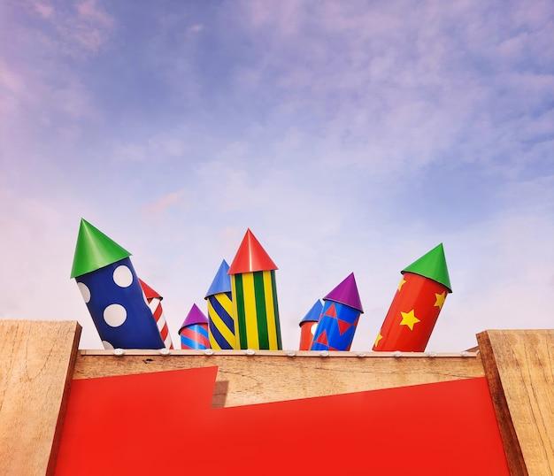 空の背景におもちゃの爆竹とお祝いのバナー。爆竹とコピースペース付きのポスター。