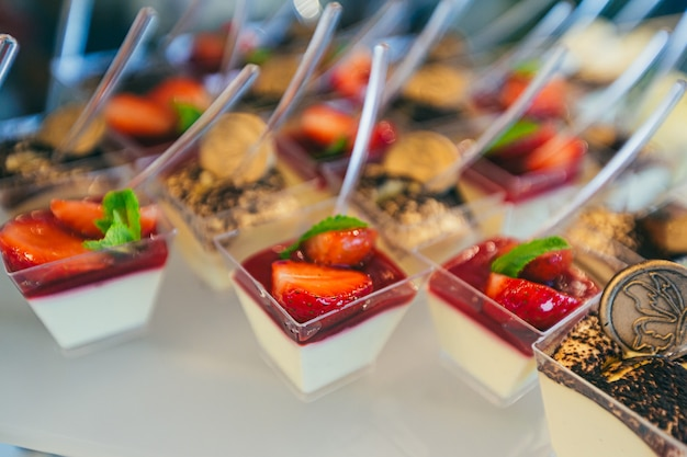 Festive buffet table with delicious desserts of different colors at the wedding ceremony