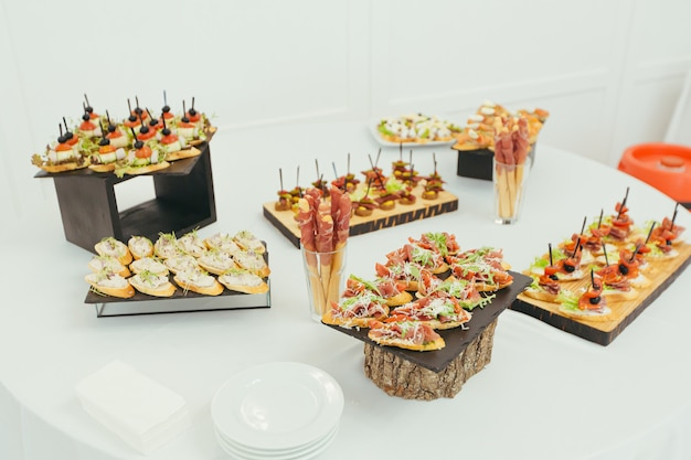 Festive buffet table with various snacks of fish and meat
