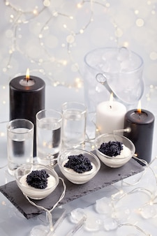 Festive buffet with vodka and black caviar