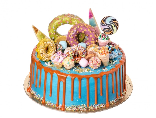 A festive cake made from sweet ornaments on day of birth.