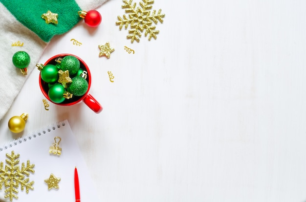 Festive christmas accessories on white wooden background