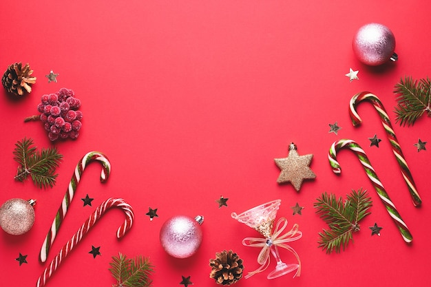 Festive christmas border with golden elements on red flat lay top view copy space