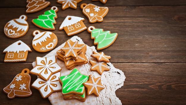 Festive christmas gingerbread cookies in the shape  a star lie on a wooden dark brown .