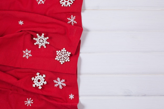 Festive christmas kitchen tablecloth or napkin on wooden table. top view