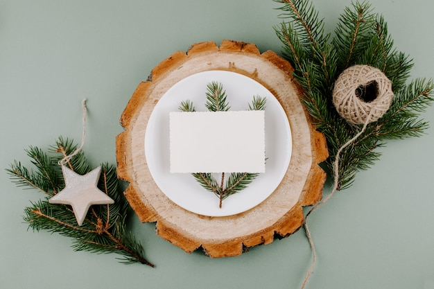 Festive christmas natural style table setting with empty card