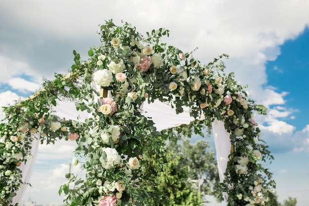 A festive chuppah decorated with fresh beautiful flowers