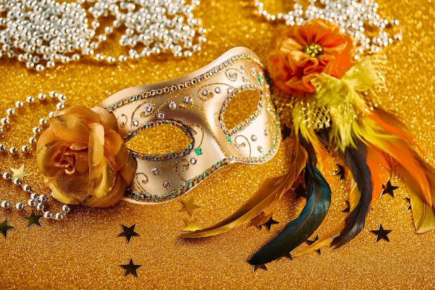 Festive, colorful mardi gras or carnivale mask with feathers and beads. venetian masks. venetian carnivale celebration concept.