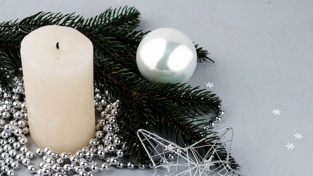 Festive composition of candle and ornaments