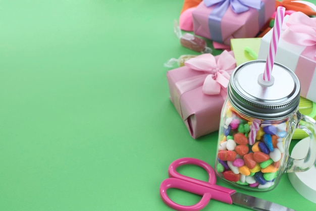 Festive composition set of gift boxes with balls candy cocktail materials.