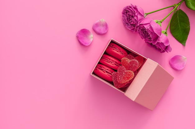 Festive composition for valentine's day . pink rose, box with macaroons