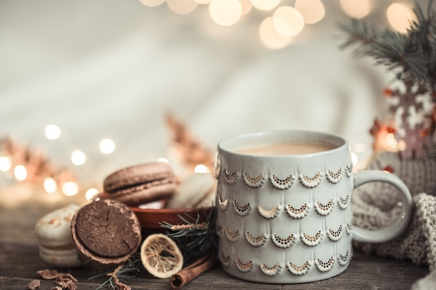 Festive composition with cup on wooden surface with lights