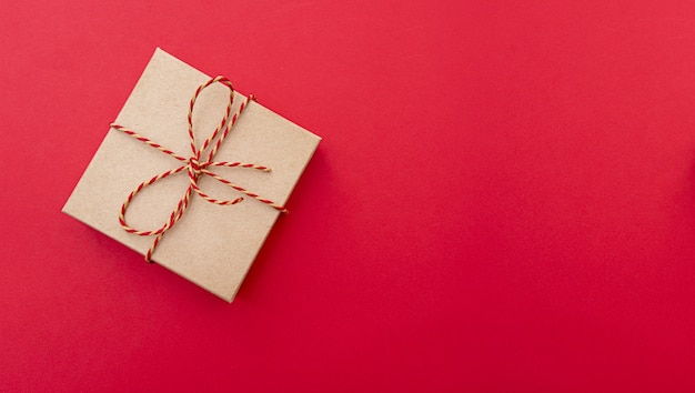 Festive composition with gift box. paper box with ribbon, top view