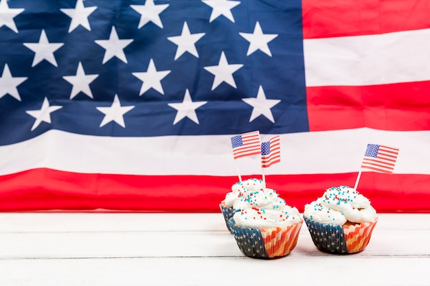 Festive cupcakes on background of usa flag