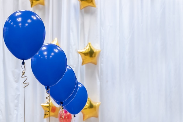 Festive decorated selling with blue tone helium balloons