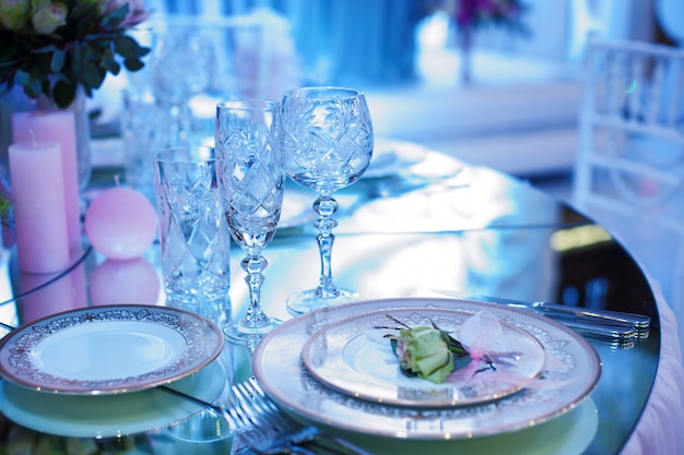 Festive decorated table in the restaurant for christmas in blue and white tone