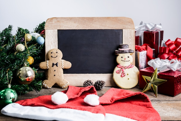 Festive decoration, christmas cookie, new year in shape of snowman, gingerbread man on woo