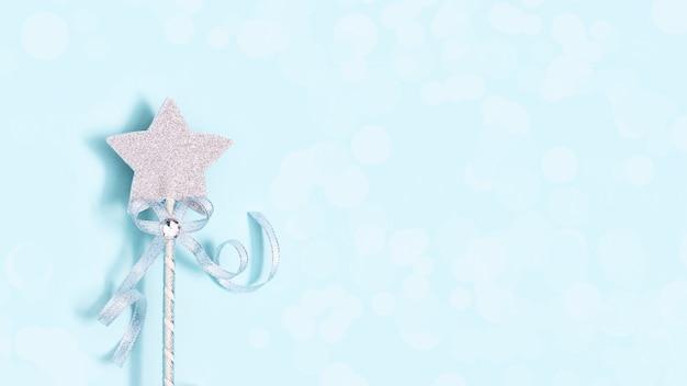 Festive decoration, magic wand, bright silver star with shine