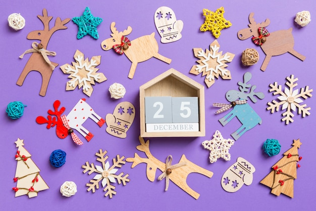 Festive decorations and toys. top view of wooden calendar. the twenty fifth of december. merry christmas concept
