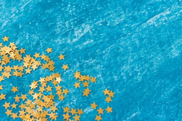 Festive decorative wit hstars on blue textured