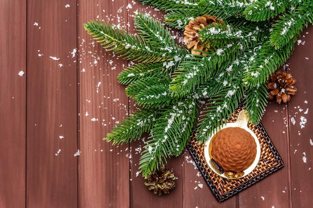 Festive dessert in the shape of a christmas fir cone. new year sweet treat concept.