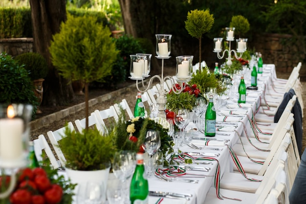 Festive dinner table decorated in white and green tones
