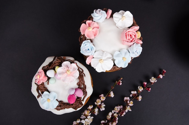 Festive easter cake with flower decorations and spring flowers