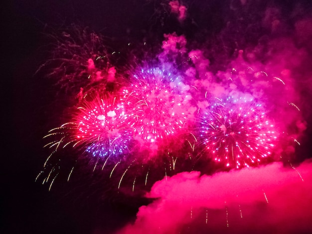 Festive firework in the sky at night - holiday celebration