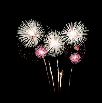 Festive fireworks exploding over night sky, isolated on black background