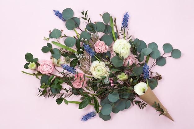 Festive flower composition with kraft paper cornet