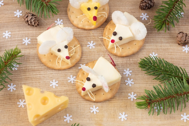 Festive food for the new year - year of the white mouse (rat). mice shaped cheese appetizer. christmas mood.