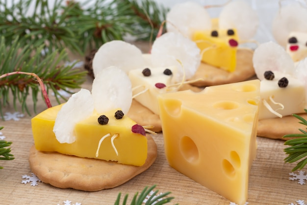 Festive food for the new year. year of the white rat. mouse shaped cheese appetizer. christmas mood.
