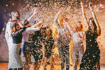 Festive friends in confetti together