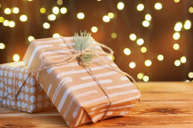 Festive gift box on wooden table